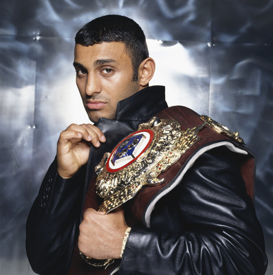 English featherweight boxer Prince Naseem Hamed posing with his WBO featherweight champion belt, circa 1995. (Photo by Terry O'Neill/Getty Images)
